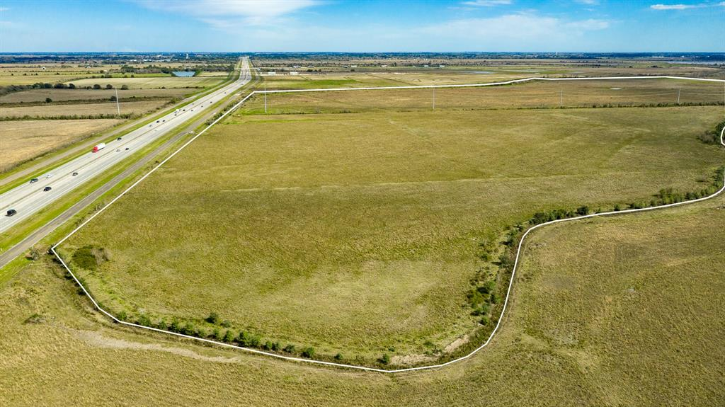 """229.8824 Acres of prime land on south side of I-10 E in East Chambers County near Winnie TX.  The property""""s eastern boundary is the center of Rush Ditch.  The property's western boundary is the center of Ogden Ditch. Nearest north-south road crossing I-10 E is FM 1410 to the west of the property.  Nearest road to the east side of the property is Oak Island Rd. Property contains 10,013,675 sq ft.  Approximate frontage on I-10 East is 2766.38 ft. Property has electricity. Seller has paid Trinity Bay Water District for water and sewer to the property, 8"""" water line and 3'' sewer line. Buyer will have to pay for connection. Has AG Exemption. Seller reserves minerals with a non drilling provision."""