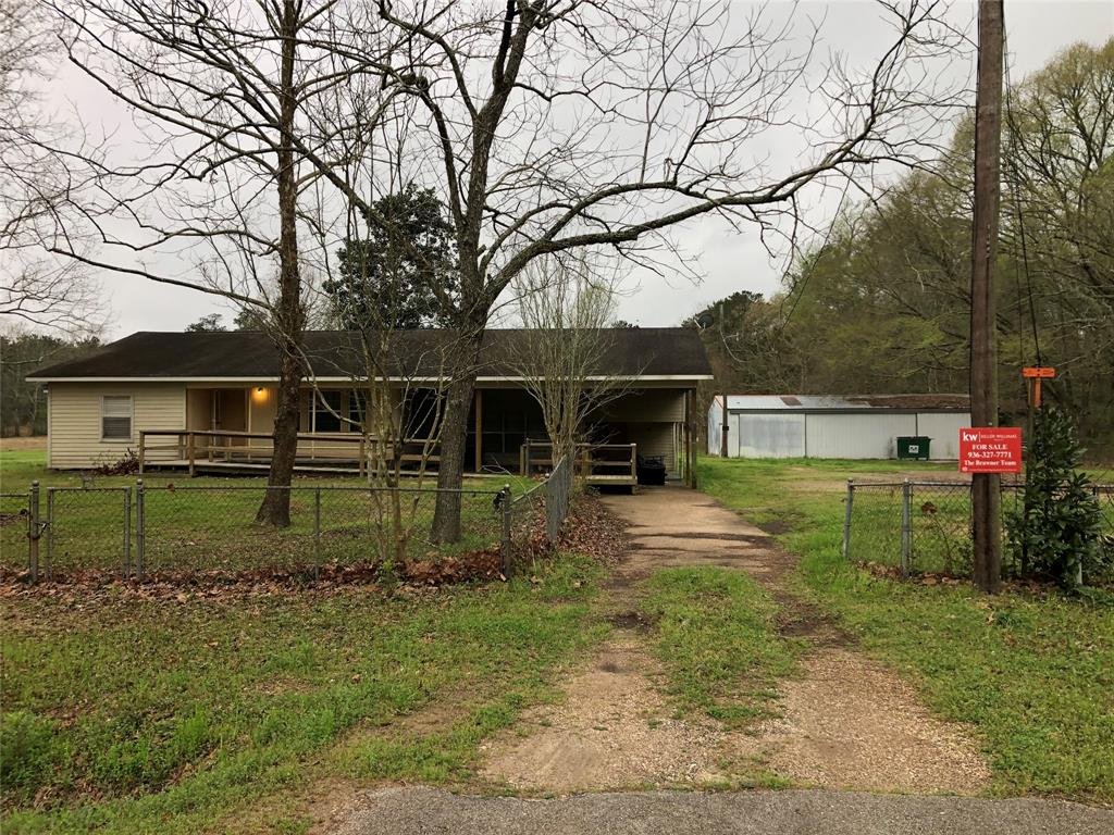 Great place for you in the country! Over 9 acres of land, and a one story home with 3 bedrooms, two baths, large living room and quaint kitchen. Outside there is a huge barn/storage building and a storm shelter.  Property is fenced in and has a porch across the front.