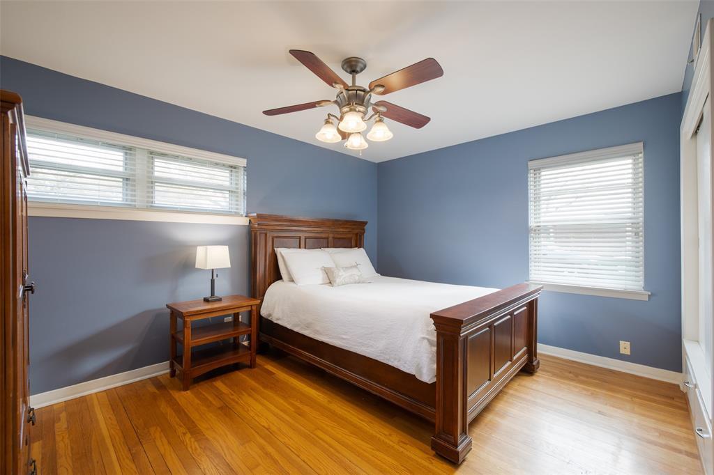Bedroom # 2 features wood floors and en-suite half bath.