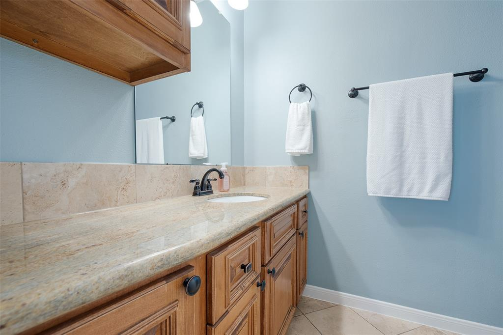 Full bath # 2 with granite counter top and updated tile and vanity.