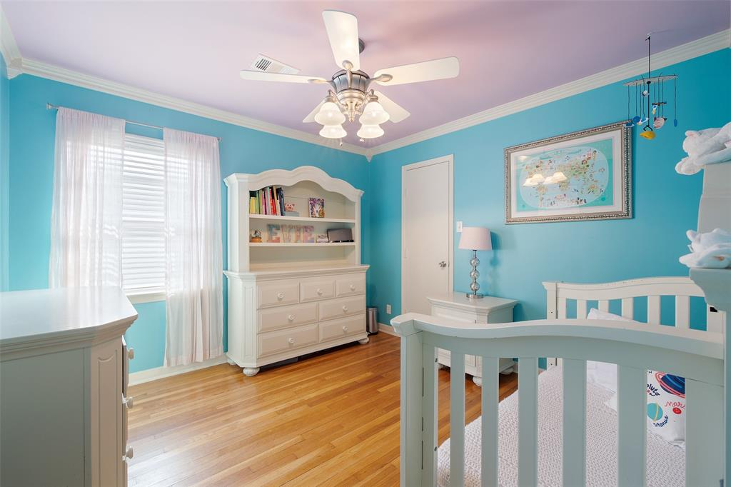 Bedroom # 4 features wood floors and crown molding.