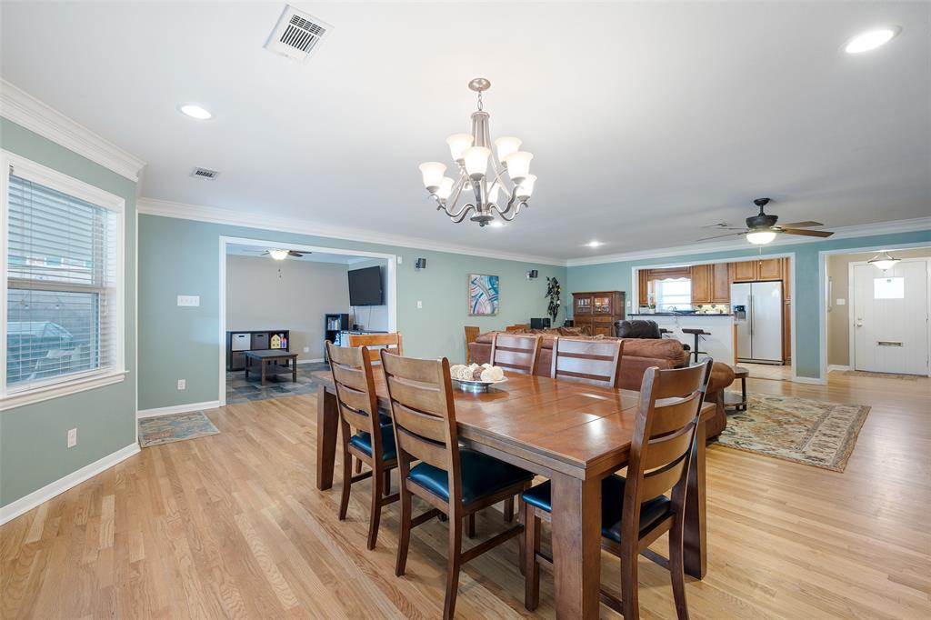 The dining space can easily accommodate an eight person dining table.