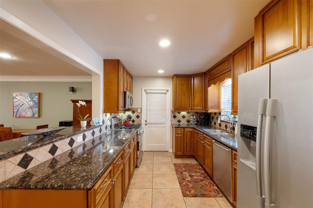 The family chef will love the updated kitchen that features granite counter tops, gas range and stainless steel appliances.
