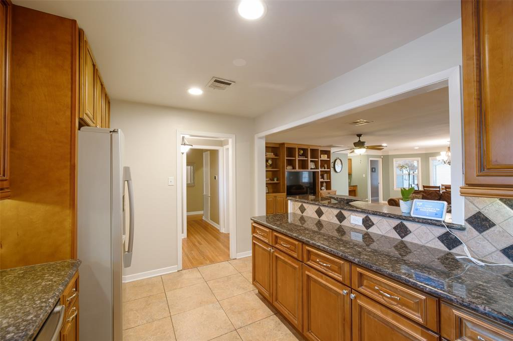 The kitchen opens to the living space and also features a breakfast bar.