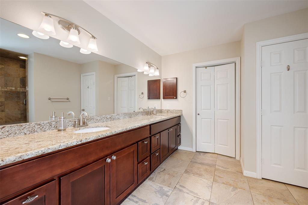 You will love starting your day in this massive primary bath that features dual vanities, granite counter tops and lots of storage.