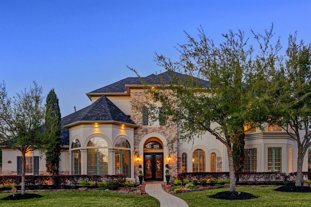 Treat yourself to pure luxury at the exclusive Reserve at Spring Lake gated section in Cinco Ranch w/ this resort-inspired residence that will spoil you to everything else! A finely curated & architectural triumph, this custom-built 5BR home seduces w/soaring coffered & tray ceilings, regal columns, rich wood floors, ornate ironwork, elegant lighting updates & fresh interior paint. The 2-story great room commands regal attention before flowing into an updated chef's kitchen & breakfast area. A sumptuous primary suite indulges w/spa-like ensuite & custom walk-in dream closet. Additional accommodations include a second suite on the main floor & three ensuite bedrooms upstairs, along w/theatre room. The layout excels in sophisticated indoor/outdoor living where a sizeable game room & pool bath access a backyard oasis w/fabulous pool/spa & veranda w/summer kitchen. Amazing storage throughout, 3-car garage, Control 4 smart home system. Recent roof and water heaters.