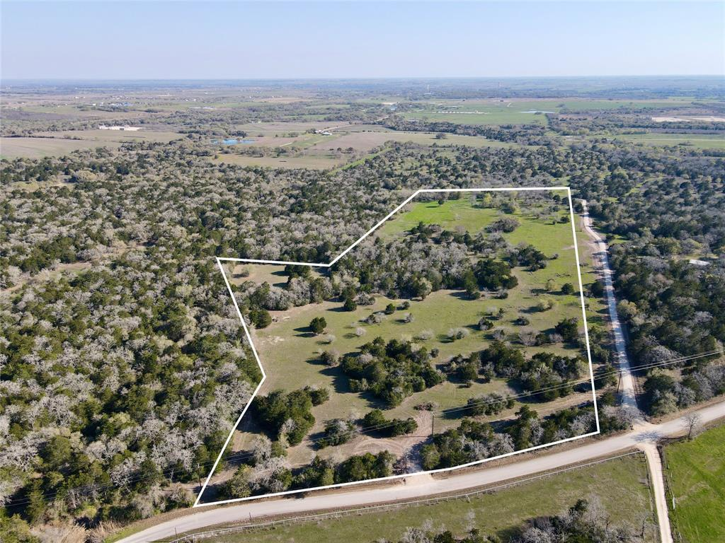 Rare, hard to find small tract of land in Lavaca County. 22 acres with mature trees and space to build your dream home! Great building sites with natural privacy from the road and the neighboring properties. Perfect weekend getaway to build a barndominium, barns, or a shop. Fenced catch pen for livestock already in place. Just minutes off Highway 95 in between Moulton and Flatonia. Paved road frontage, new entrance, and ready to be built on! Properties this size are hard to find in this area! Come take a look at this awesome tract of land! Ag Exemption in place. Additional acreage available.
