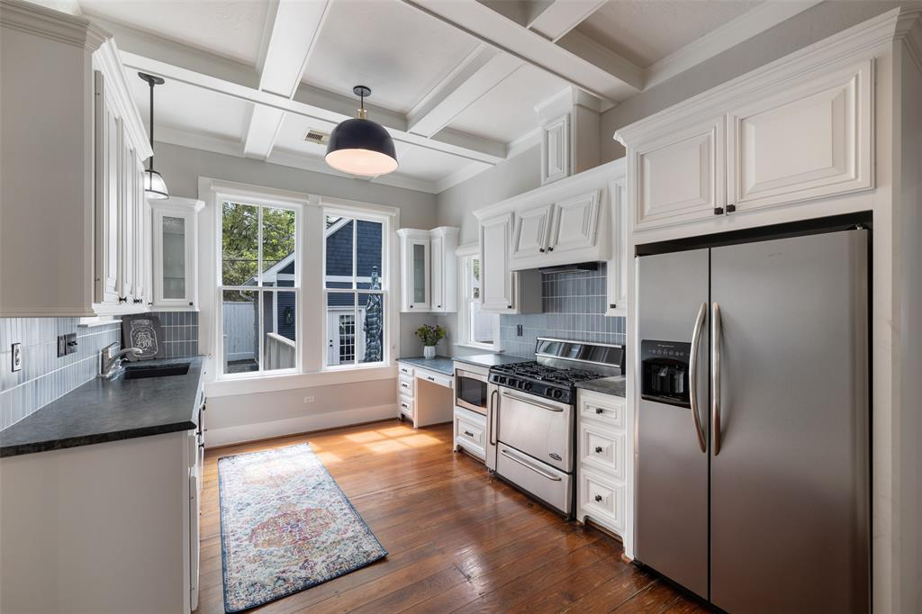 The light fixtures, backsplash, and paint were all carefully picked to make this space bright and airy.