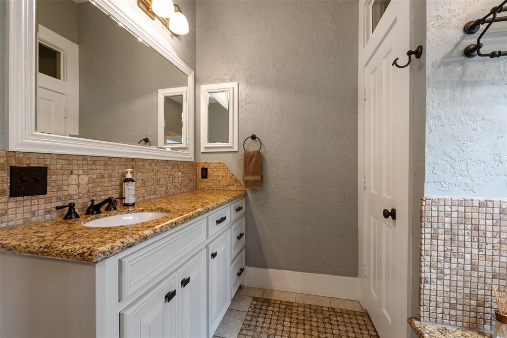 A sink and ample counter space on each side of the primary bath.