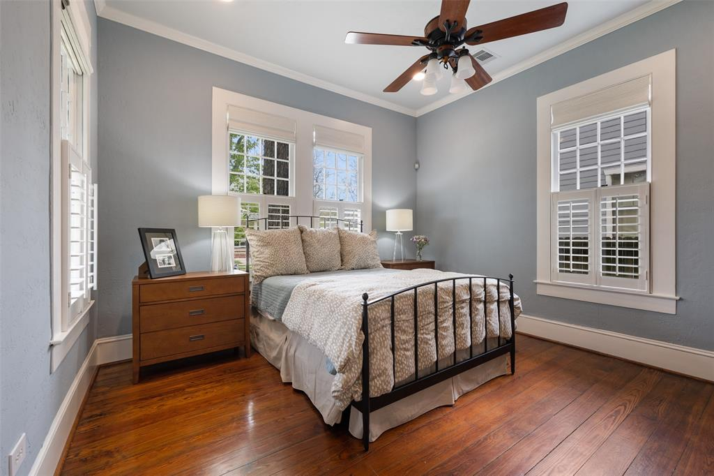 Guest room on the first floor is perfect for visitors. The windows make it bright and charming.