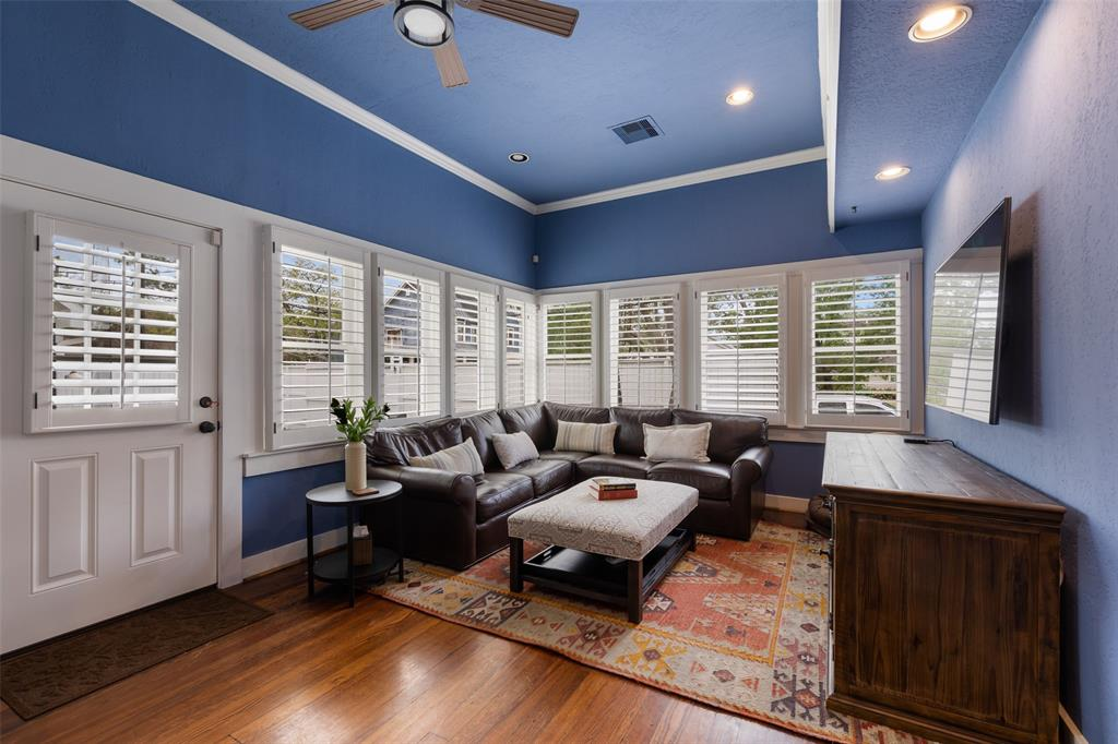 Third bedroom (or den) is beautiful, with window filled walls, entry to the backyard space and painted the perfect color for a charming heights house.