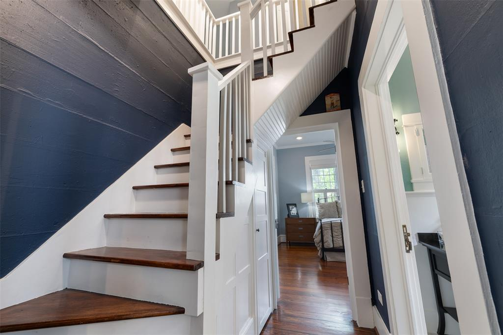 Original stairs leading to a spacious 2nd floor.
