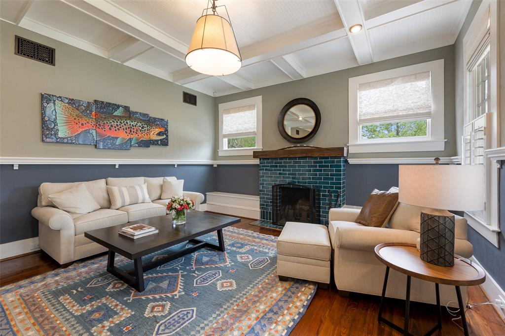 As you enter the living space is on the right with a refurbished fireplace and paneled ceilings.