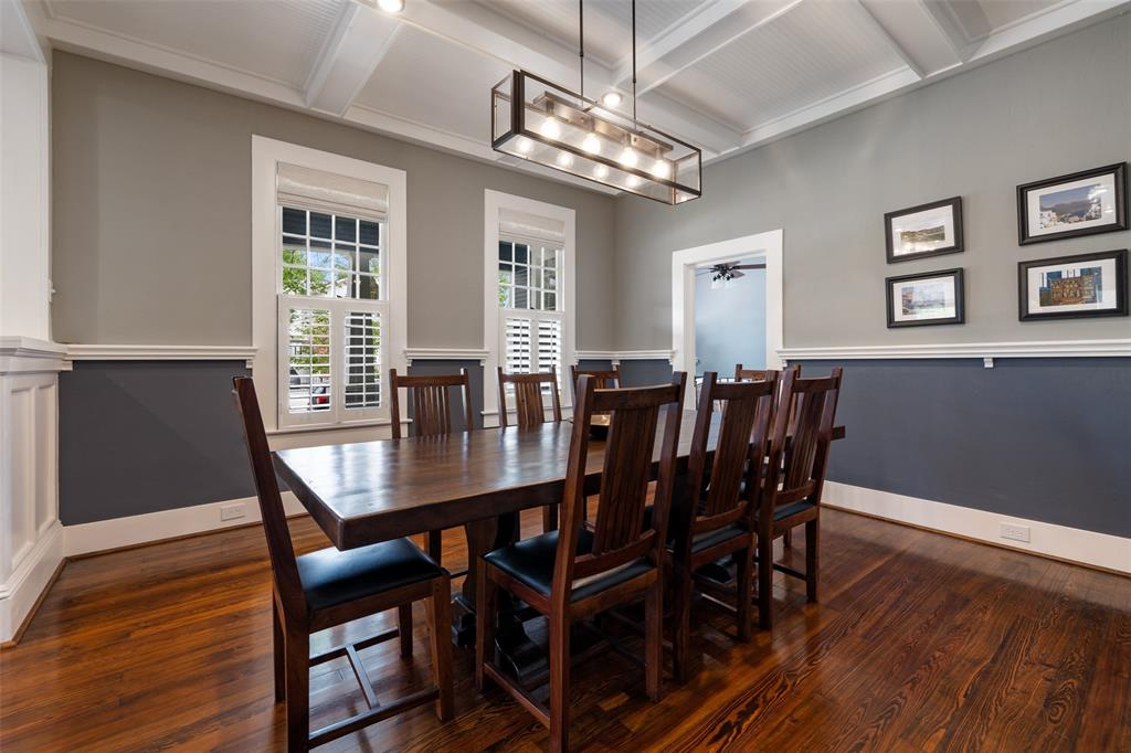 Dining area with new light fixture and wood floors throughout.