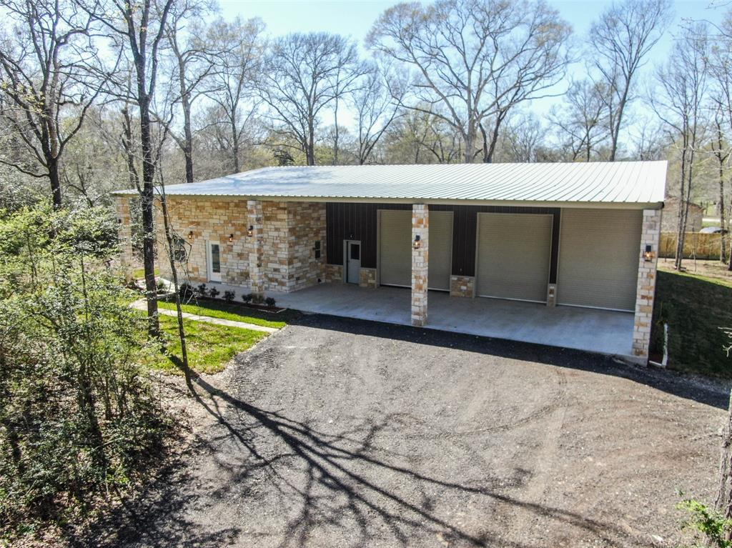 * New Construction* Custom Built 3 Bedroom, 3 Bathroom Barndominium in Hempstead! Move-In Ready! This Modern Farmhouse Barndominium is a Pinterest Lovers Dream! Showcasing Stunning Design details from the front Stone Exterior & throughout the interior of this open floorplan. As you enter you'll notice the beautiful laminate floors flowing throughout into the Large Bright Kitchen boasting custom cabinets, SS Appliances & a massive Granite Island, a perfect place to entertain! There is a large walk-in pantry & separate utility room w/plenty of extra storage. The Living Room is open w/high vaulted ceilings, trimmed with crown molding. The Master bath has double sinks, a farmhouse tub & a glass shower. Plus 2 additional bedrooms & an upstairs Gameroom! You'll love the 38x44 Custom Shop offering concrete floors, tons of space to park your toys, even room to park the RV with 4 Industrial Roll-Up Doors (1-10x10, 2-12x12 & 1-14x10) New Water Well & Septic Sys! This won't last long, Call Today!