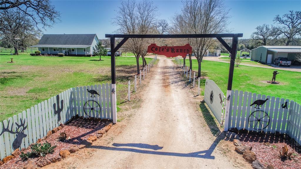 10.065 Acre Ranchette set up for outdoor enthusiasts! 1,440 Sq. Ft. 1-1/2 Story Home, built in 2008. Hardy Board Exterior, 50-year composition shingle roof, 10'x16' covered front & back porches. 3 Bed, 2 Bath, Open concept, split floor plan w/ custom woodwork throughout. Bedrooms 1&2 located on Main floor w/ Baths offering walk-in tile shower & spacious closets. Kitchen boasts granite countertops & custom wood cabinetry. Walk-in Pantry. 16'x24' Kayak Pool w/ 8'x20' aluminum deck. 54'x40' Metal Building on Slab w/ 24'x40' Covered Carport & 2 -10'x10' Rollup Doors. Guest Cabin w/ 1/2 bath. 42'x20' FUN Space w/ covered front porch includes 24'x40' Kitchen w/ custom woodwork connected to 18'x20' Game Room/Man Cave.14'x16' building on slab. 8'x12' insulated portable building; 30'x40' Steel equipment barn. Cattle pens w/ 3-sided shed; Dog Kennel, Garden Area; Lighted Horseshoe Court; Covered Pavilion w/ Lights. Firepit area; Firewood Shed; Concrete sidewalks connect all out-buildings.