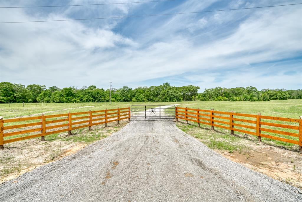 Beautiful Acreage Located in Eastern Madison County on FM 2158, Midway. Madisonville ISD 20.00+/- Acres presenting approximately 50 open; 50% wooded with several mature oak trees, paved road frontage, and evidence of abundant wildlife. Featuring a new driveway and entrance, new perimeter fence, new water well, and underground electric. There are several nice homesites available, room for raising some agriculture, and recreation activities. There is enough acreage to have some space between you and your neighbors and there are light restrictions (no HOA). Build your dream home, a barndominium or a cozy cabin to enjoy full time or as a weekend retreat in the country.