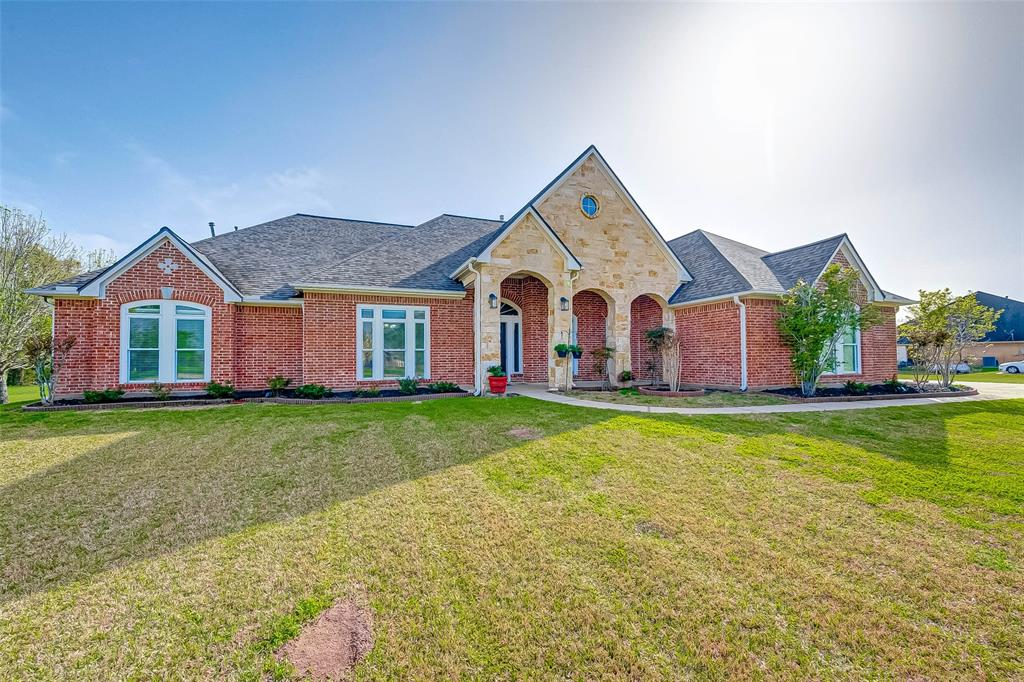 Welcome to True Country Living. Built at 3,635 sqft, this custom home offers amazing space for everyone. It sits on an acre lot in the beautiful Brazos Lakes Subdivision and offers space and privacy. There is also a small thicket of trees and a small stream that marks property line.  This home has an Open Concept floor plan with a large kitchen which opens to a beautiful living room. The kitchen offers new stainless steel appliances and gas stove top. It has a large center island for serving.  With both casual and formal dining, this home is perfect for large gatherings of family and friends.  The large patio is the perfect setting to start your day or close out the evening.  Entertain everyone with a large gameroom up stairs. 7111 Brazos Lakes offers you the perfect balance of country living while being close to the city.