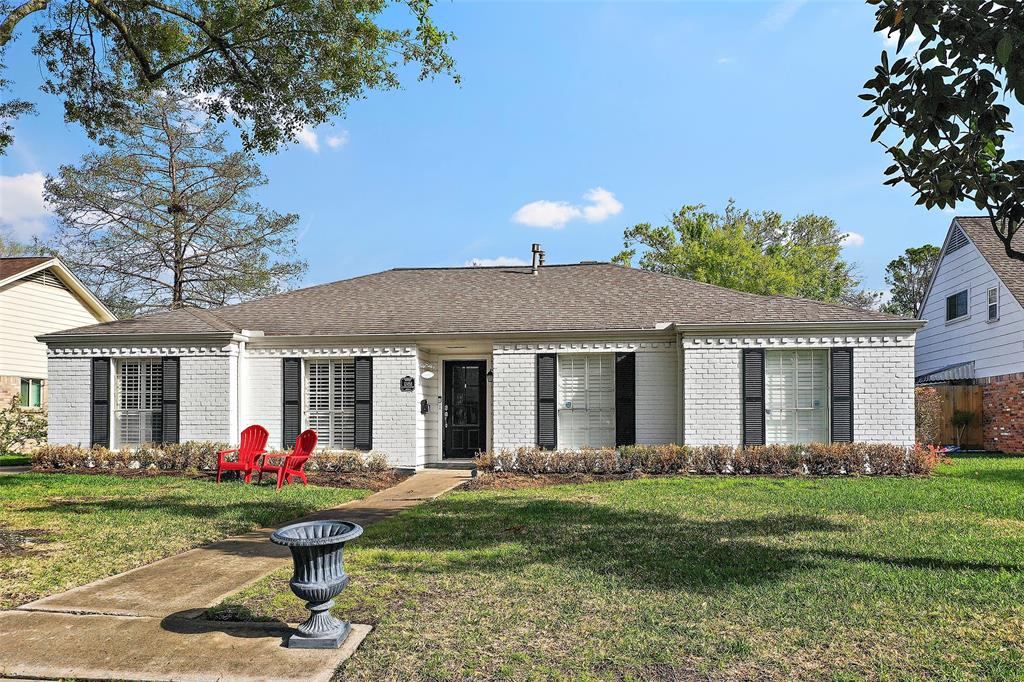 Beautiful traditional ranch style home located on quiet cul-de-sac in the heart of Memorial.  Home features 3/4 bedrooms, 2 bathrooms, sparkling pool, 4 car garage, large lot, floor to ceiling windows, solid surface flooring, 2016 roof, and flexible floor plan.  Kitchen with white cabinetry 5 burner gas range, double ovens, separate prep sink, and breakfast bar.  Over-sized master with large seating area, double sinks, generous shower, walk in closet, and pool access.  Secondary bedrooms all feature ceiling fans and generous closets.  Home has been equipped with many smart features including Alexa controlled smart switches, Eco Bee thermostat, Hayward pool pump, Rainbird sprinkler system, and Ring Doorbell.  Large family room looks out to the sparkling pool.  Home is zoned to highly rated schools and is conveniently located near Memorial City, City Center, and Energy Corridor.  Easy access to I-10 and BW8.  Schedule your showing today!