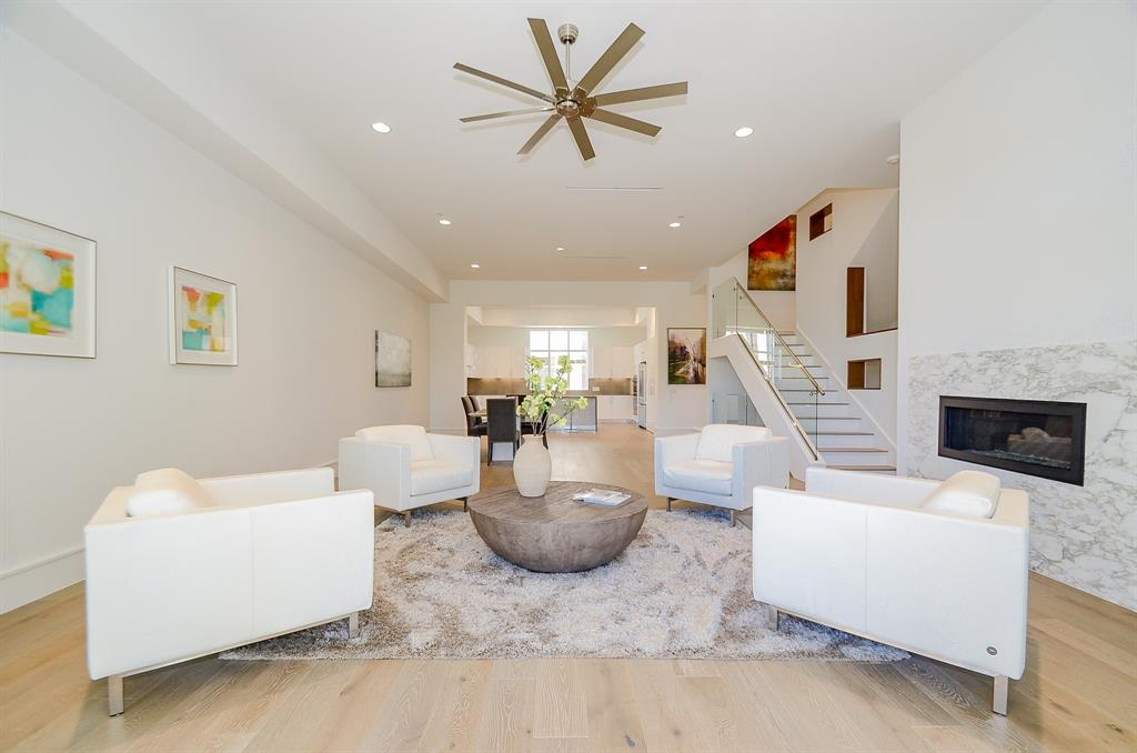"""A Contemporary Lakeview Townhome with an """"In-Town"""" feel planted in epicenter of Sugar Land! This Lock-n-Leave home has exceptional access to the city's cultural amenities, shopping, eateries & Hwy 59, 6, & 90. This Custom Build offers an open floorplan with 12 ft. ceilings, Glass Staircases, Hardwood & Tile floors. The dining room overlooks family room & Covered Balcony with Gorgeous Lake Views. The Island Kitchen features Bosch appliances, Quartz countertops & sleek White Cabinets. The 3rd floor primary suite overlooks Lake & the primary bath has Floating Vanity, separate tub/shower & Custom Closet. The 3rd floor corridor leads to additional bedroom & full bath. The 1st floor has a private bedroom & en-suite bath & the sliding door leads to the back patio with brick decking & private lake access. The Garage & Porte-cochere provides covered parking for 4 Cars & ample Storage Space. This home is ELEVATOR CAPABLE!"""