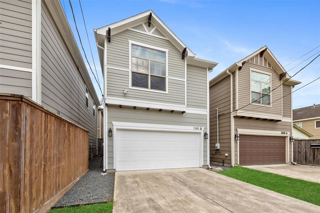 This street facing, free standing single family Heights area home offers a backyard, guest parking in this long driveway, and first floor living space.