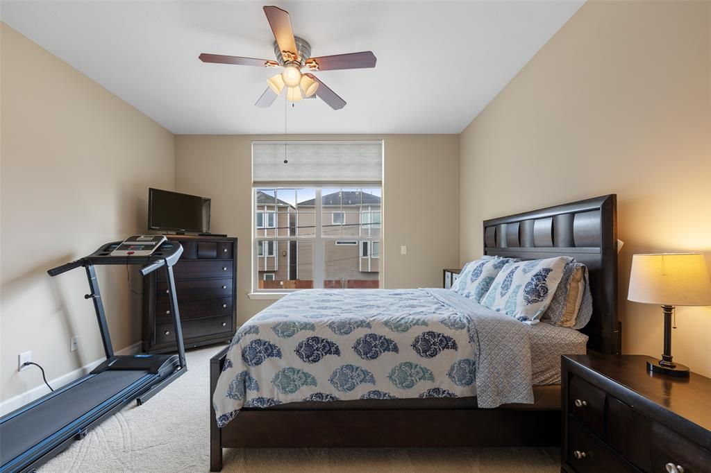 This is one of the generous secondary bedrooms. This space includes good closet space and a ceiling fan.