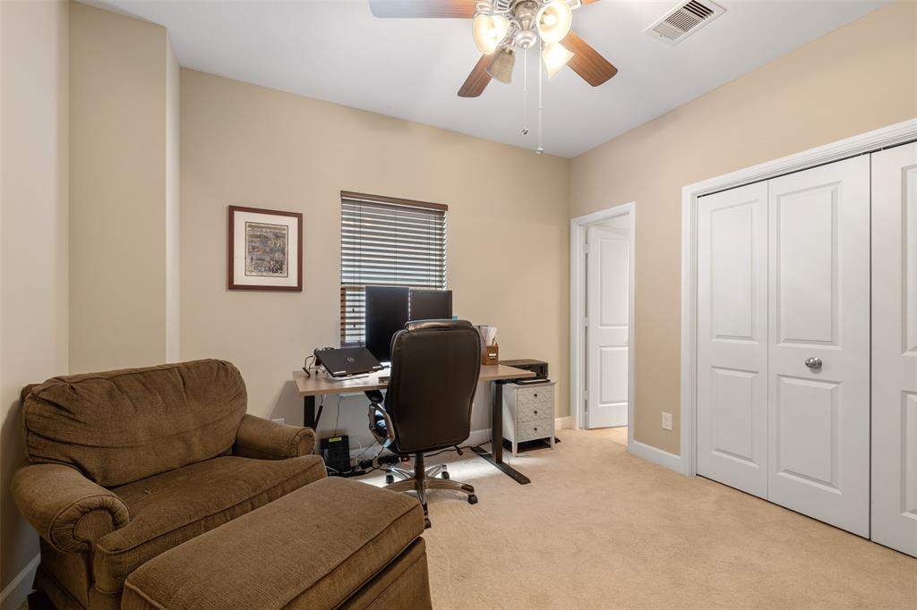 This guest bedroom also includes great close space and ceiling fan.