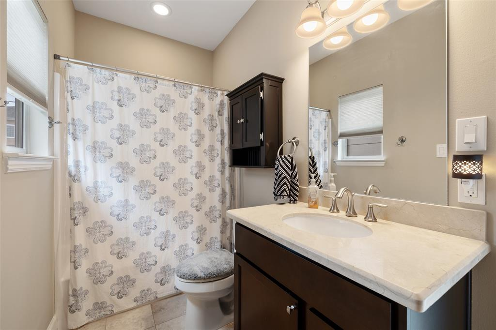 The two bedrooms are connected by this gorgeous bathroom.