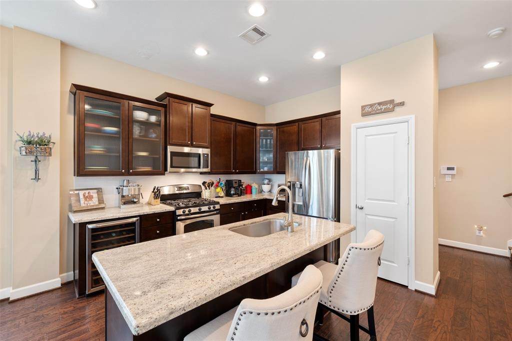 The kitchen is a great space for entertaining and cooking. The large center island includes an in-island sink and breakfast bar seating. The kitchen includes includes a wine cooler, tons of cabinet space, a built-in microwave, and a large pantry.