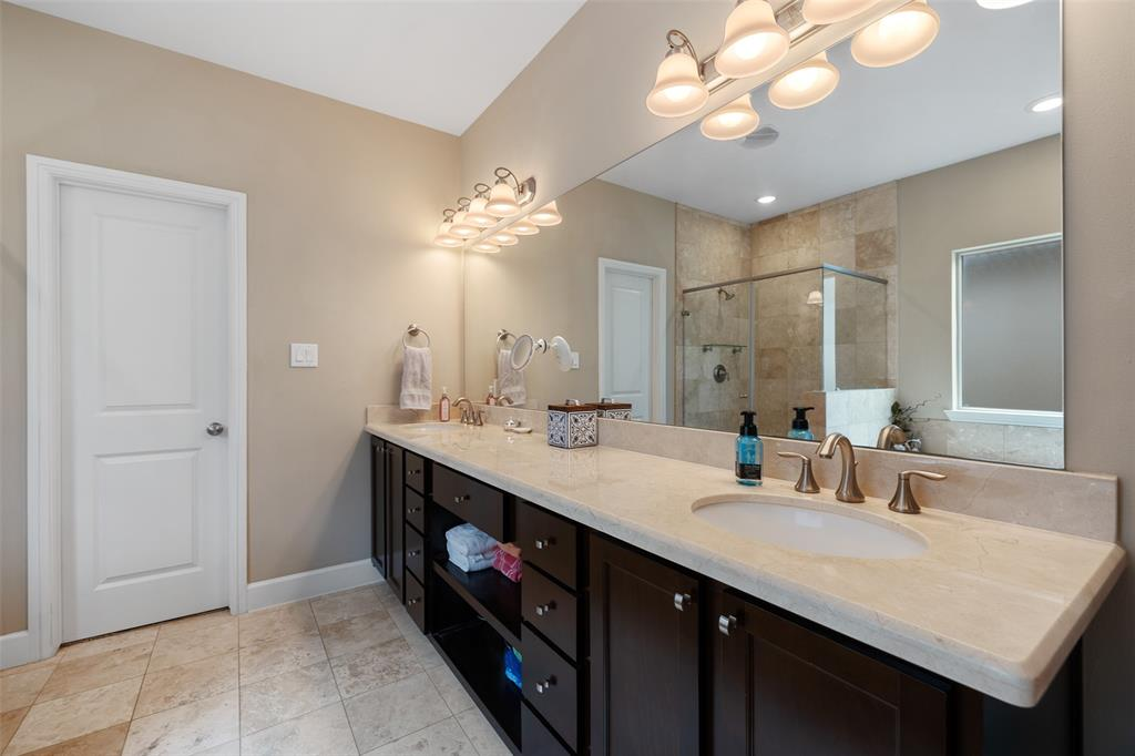 You're also going to love this large vanity with two sinks, huge mirrors, and great lighting. The master suite also includes a huge walk-in closet.
