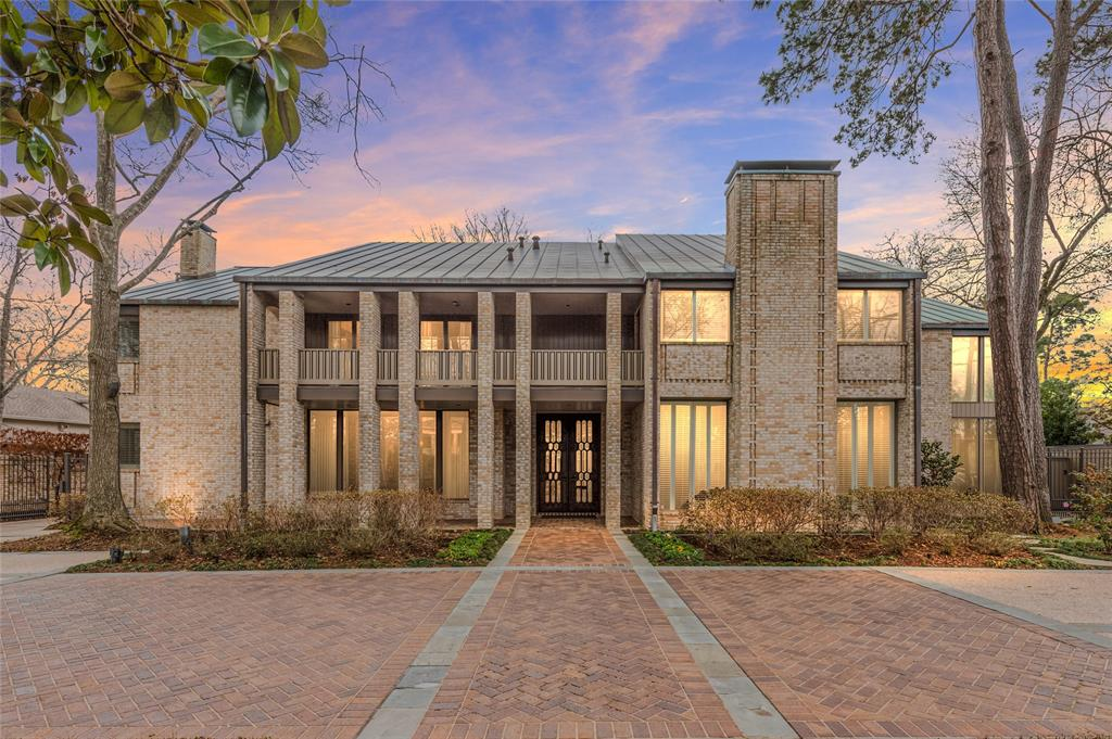 This majestic, soft-modern residence sits prominently on a tree-lined street in Tanglewood, directly across from Houston Country Club. Extensively renovated in 2006, this light-filled, meticulously designed home intrigues you as you enter through wood & beveled glass doors into a sweeping entry with exposed brick, striking staircase, & wall of glass that peers onto the lush gardens, patio & sparkling pool. Gracious formals flank the entry. The Dining Room, Chef's Kitchen & Breakfast Room, & Butler's Pantry flow effortlessly on the left side of the house. The right wing of the home consists of the Formal Living Room, Study/Home Office with Wine Cellar, informal Living Room and Great Room with wet bar & glass walls overlooking the gorgeous grounds. Upstairs is the spacious Main Suite with large walk-in closets & luxurious bath, plus four other bedrooms/baths & Game/Music Room. The large Guest House serves many purposes. Two pool baths. 70kw generator. 3 car garage. Simply elegant!