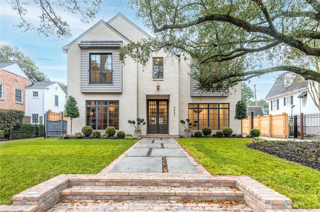 Nestled on a premier River Oaks lot, this opulent residence by Elron features manicured gardens wrapping the 11,460+/- SF lot & complimenting the Chateau Domingue finished Old Texas Brick. Floor-to-ceiling Low-E windows & custom doors allow for natural light to fill the interior. The main floor showcases 100-year-old antique oak floors, elegant dining, paneled library, spacious living & breakfast room with open concept to the marble island kitchen with Thermador appliances, and wet bar. Upstairs awaits an incredible owner's suite with sitting area, coffee bar & spa-like bath, three en-suite secondaries, spacious theatre room & utility with pet-washing station. The third floor includes a large game/flex room. A folding glass wall from the living opens to the serene backyard with ample green space, lanai with fully equipped summer kitchen, and numerous sitting areas. Amenities include Generac 32kw generator, sprinkler system, elevator equipped, smart home tech with auto lighting, & more.
