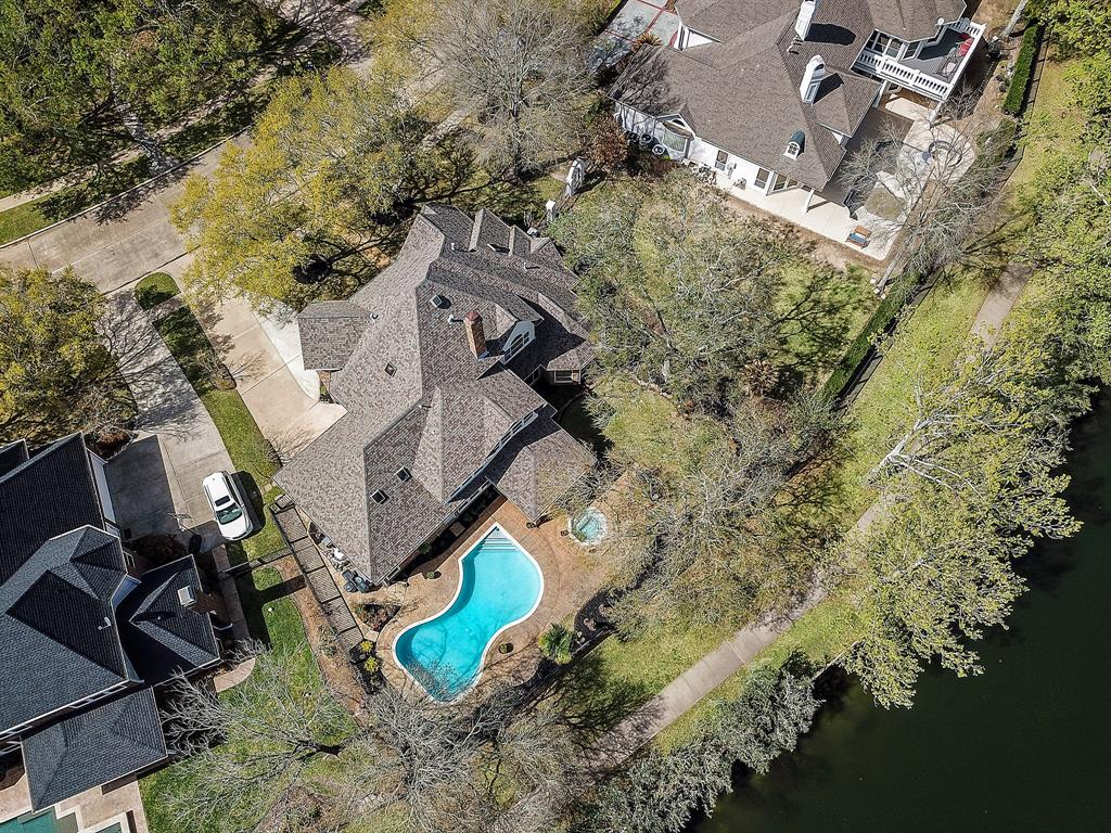 Stunning, custom-built home in the private gated community of Cinco Ranch South Lake.  You'll love the backyard paradise where you can enjoy the beautiful lake views and private pool!  Crown moldings, plantation shutters, dual-sided fireplace. built-ins throughout, island kitchen, the list goes on!  Walking distance to Cinco Ranch Beach Club and just minutes from golf, shopping and dining.  Don't miss this rare opportunity to own this water view home!