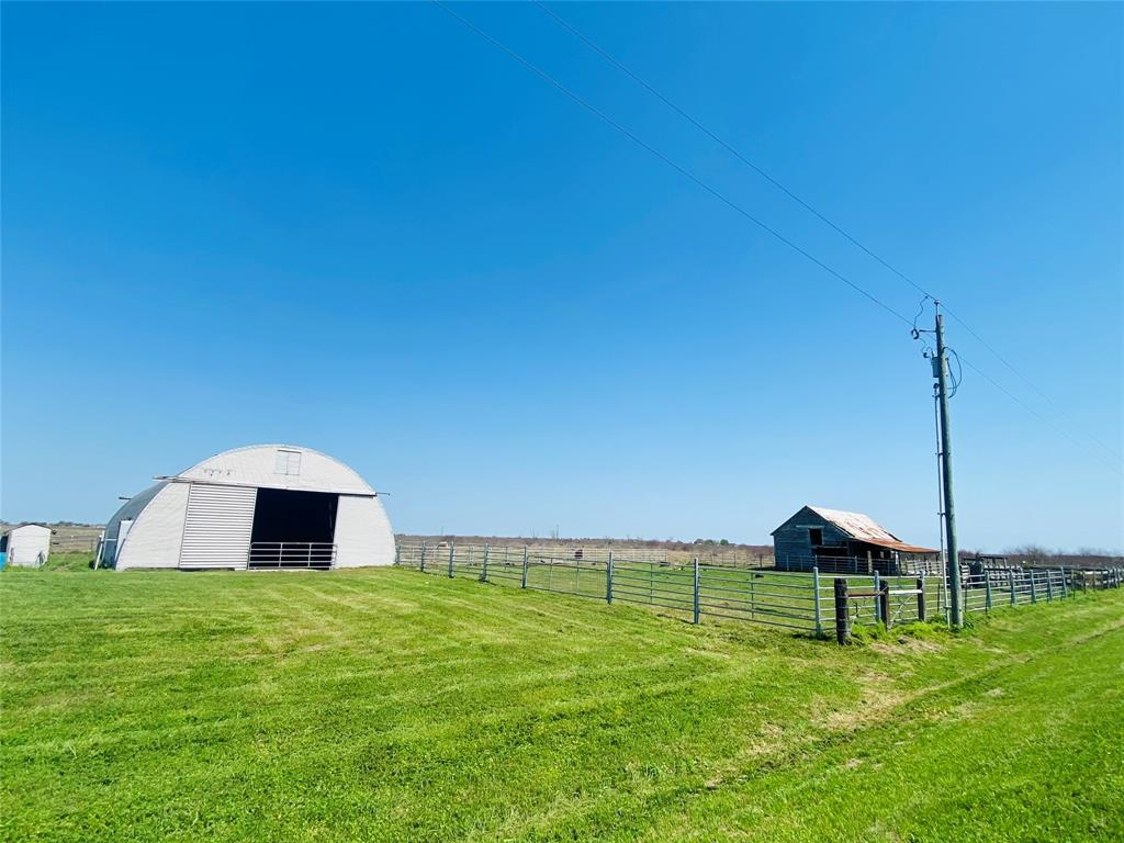 Rare find in this area - 70 acres with a water well and a 3600 Quonset building with a cement floor. Be close to amazing fishing but without the expense of being in a flood zone! The property is also in Calhoun County where the taxes are only 1.9%!! Owners have spent the last couple of years having the pasture sprayed by plane and ground to kill the huisache. Still some there but they appear to be dead! The 70 acres have been planted in coastal and there is still some there but needs some TLC. One fence line is in fair condition, the others are newer. Working pens and a catch pen were just built out of metal! 200amp electrical service installed and a water well by the Quonset building. There is also an irrigation well believed to be approximately 900' in the center of the property. The well is drilled and casing set but no pump is currently in place. The house that shows on some aerials is no longer there. No minerals will convey.