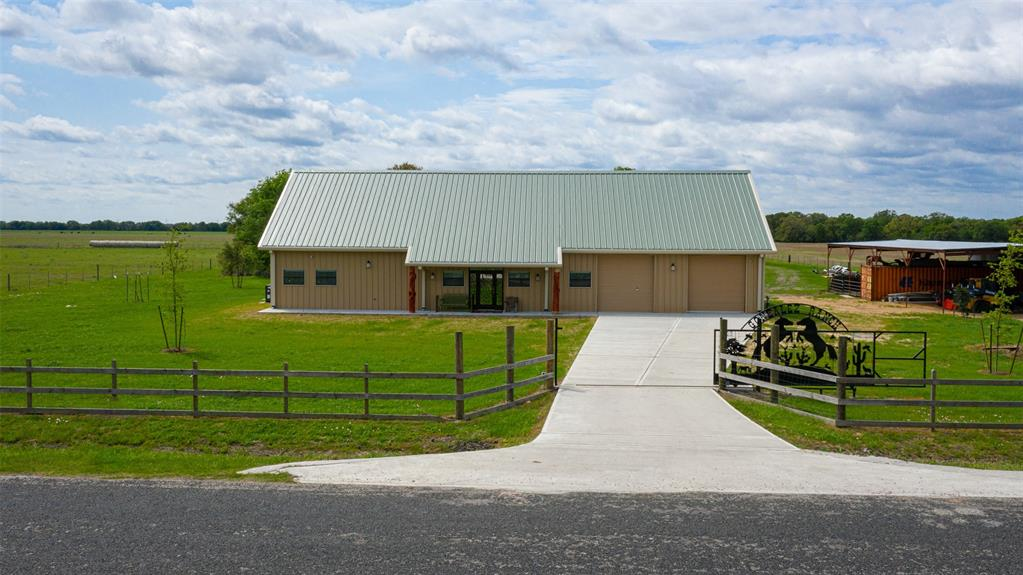This beautiful one year old Ranchette on 21.336 acres has endless potential.   Set up for 3/4 bed dream home, possibly a bar and grill, cafe, lodge, bed n breakfast or whatever you need it to be.  Currently a Ranchette fenced and cross fenced for cattle/horses, nice pond w/rock waterfall, huge covered patio with brick outdoor fireplace w/pizza oven & grill.   Wooded at the back great for deer & hog hunting, lots of wildlife.  All high end finishes, this barndominium has a steel frame structure, totally insulated, solid wood doors, custom front door, custom cabinets, commercial size gas range, beautiful granite countertops, a full wet bar area and it also comes completely furnished, accessories and everything else you see in it. Two gorgeous staircases with wrought iron railing, 2 upstairs lofts open to below.  Huge storage barn outside, concrete drive and custom made entry gate.   There is too much to list on this one.   Must see it!   Call today to schedule your private viewing.