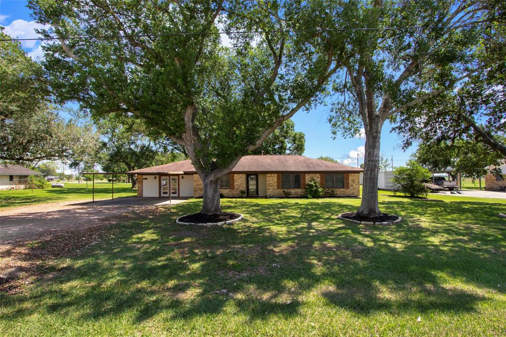 Welcome to 8815 Terry St. in East Bernard, TX! This charming ranch style home is sitting on almost an acre of land just a few minutes from the heart of town and only a 5 minute drive to EBISD! This 1910 square foot home is nestled under gorgeous oak trees with a fully fenced back yard and is an entertainers dream! It features an open concept living, breakfast, dining and kitchen area and the possibilities are endless! It has updated bathrooms and tile through-out! Call today for your private tour! It won't last long!