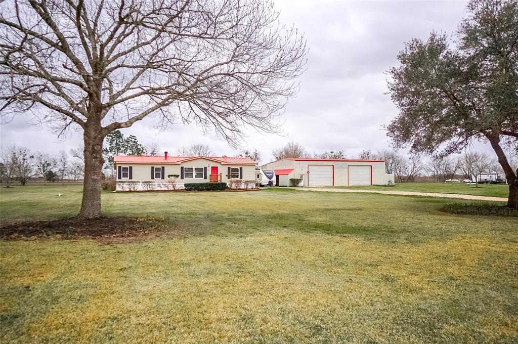 Unrestricted 3.76 acres,  3 bed 2 bath manufactured home, 30x60 concrete floored shop; 22x60 addition to the shop that has dirt floor could be converted to barn area for animals, shipping crates currently used for storage, fenced backyard behind mobile home. Great frontage on Hwy 60, property has city water and sewer and underground utilities. Currently property is total electric but city gas is available. RV is not part of the sale.