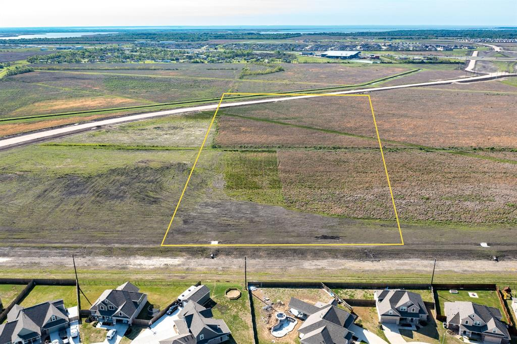 GREAT 26.152 ACRES ON FM 1409 EXTENSION. GOOD FRONTAGE ON FM 1409 EXTENSION. TRACT IS SHAPED WELL. CITY UTILITIES WILL BE AVAILABLE FROM THE CITY OF MONT BELVIEU. PROPERTY IS UNRESTRICTED. SELLER'S RESERVES ALL MINERALS OWNED BY SELLER. BUYER WILL NEED NEW SURVEY.  DRONE PICTURES MAY NOT BE ACCURATE .SURVEY NEEDED TO DETERMINE EXACT LOCATION OF THE TRACT.