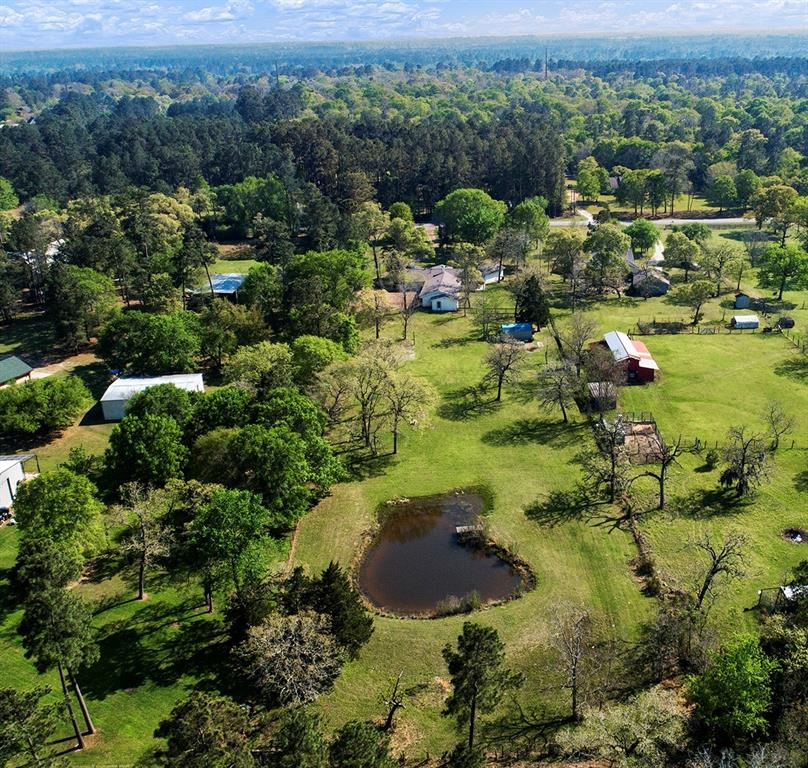 Welcome to Heavenly Meadows! If you are looking for your own peaceful piece of paradise – look no further. This one-of-a-kind one-story ranch home was torn to studs in 2020 and renovated with high-end finishes throughout. Complete restructure of the common areas designed for modern open concept living. Restructure includes an oversized kitchen with island/breakfast bar that opens to the formal dining and living room. Super pantry added for extra storage. Master suite on each side of the home. Upgraded windows provide stunning views of your property from every room. Relax with your coffee on one of the two Texas style porches, listen to the birds and admire the deer. Guarded by a private electric gate and fully fenced/cross fenced to separate your large and small animals. Enjoy the beautiful open skies on this 2.79-acre stunning mini ranch. Spend your afternoons fishing in the fully stocked pond making memories. Too many upgrades to list. Schedule your appointment today.