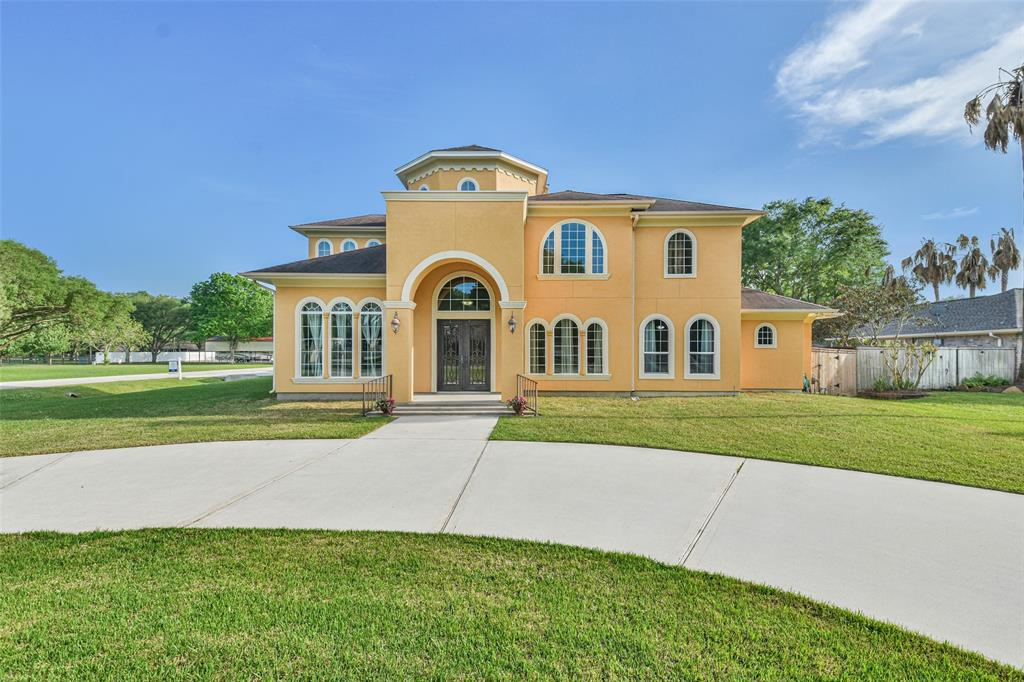 The best of both worlds--large acre lot 4Bed/4.2 Bath/3 car garage home with $75 x year HOA fee and no MUD zoned to wonderful CFISD schools.  Home was custom built in 2014 with 27 ft grand entry, all tile floors in main living areas, double paned windows, 8 ft doors, crown molding, tray ceilings w/lighting and many more details.  Kitchen has all Stainless Thermador appliances including 6 burner gas stove with griddle, solid Oak cabinets, huge island and double convection ovens.  Large Family room with 60' ceiling fan & fireplace that's never been used.  Primary Suite has wood floors and bath has jetted tub, 2 vanities, double shower heads and His & Hers walk in closets. Must see Game Room w/built in wine rack in cabinet, sink and granite counter.  Solidly built home w/Pex pipes, aerobic septic system, full gutters, 40 year roof, 3 Carrier HVAC--backyard ready for your pool!