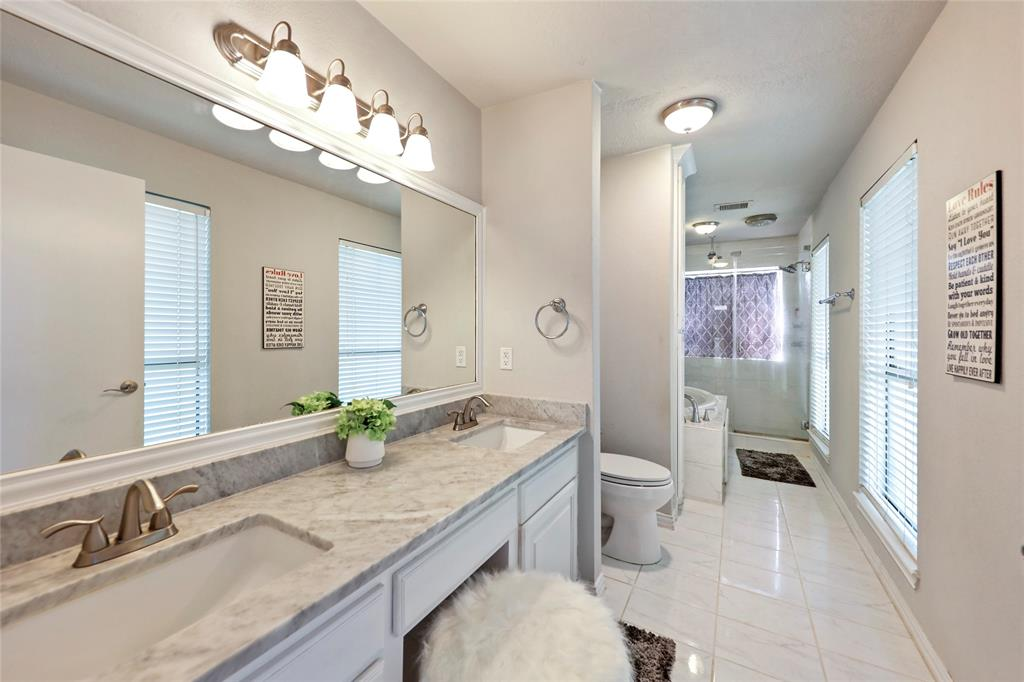 Luxurious primary ensuite bath with oversized soaking tub separate walk-in shower.