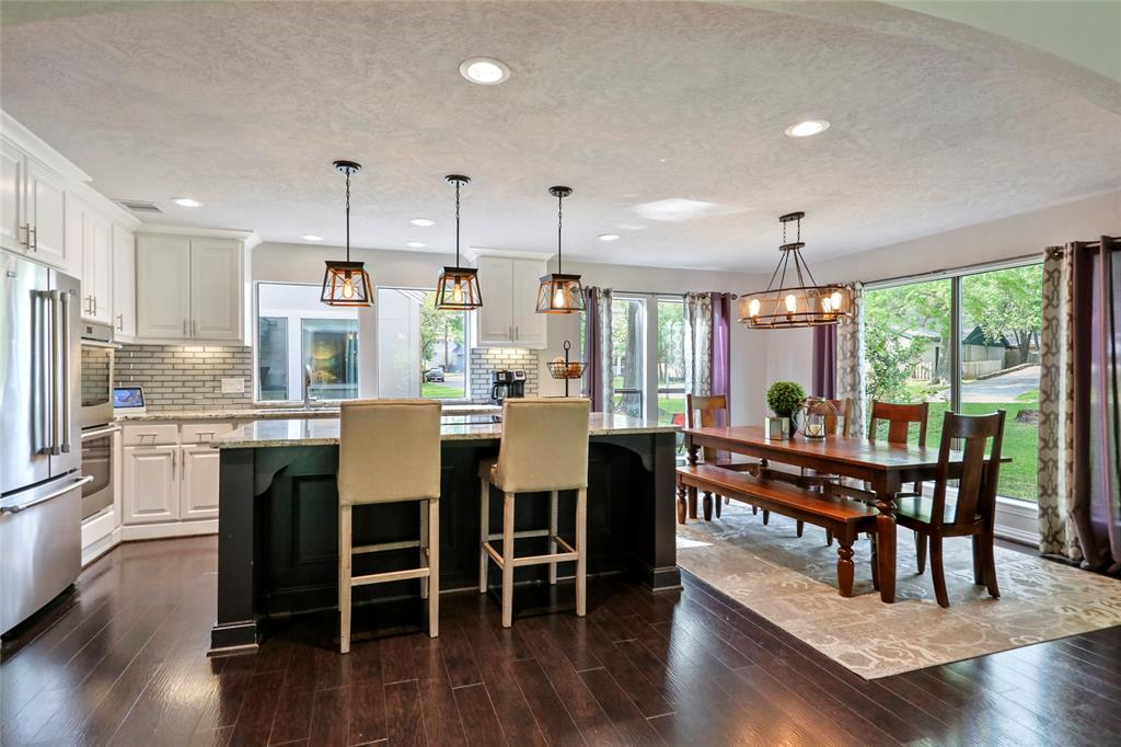 Upgraded lighting fixtures provide the perfect ambiance while dining in this stylish space.