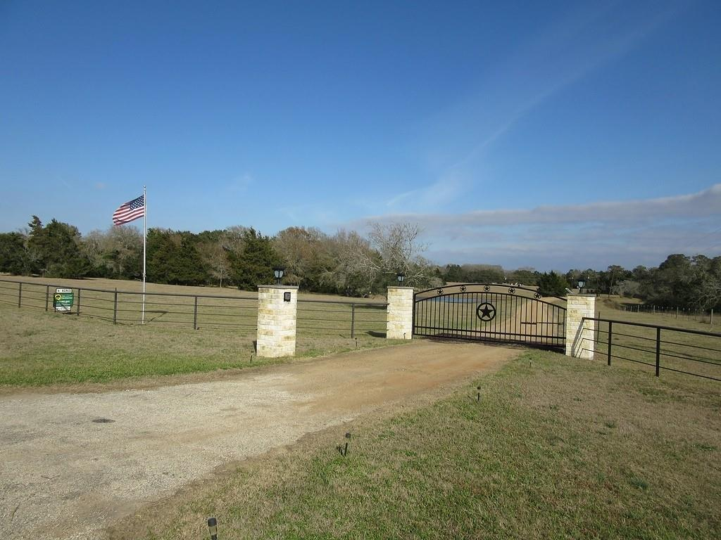 This beautiful one of a kind 42.91 acre ranch is situated on U. S Highway 77, seven miles south of Schulenburg, in the heart of the gently rolling countryside of north central Lavaca County, Texas. The four bedroom, 2 1/2 bathroom, custom home was built in 1993, by a noted area builder. It also features lots of ample storage, built-ins, a laundry chute from upstairs directly into the downstairs utility room, and easy walk-in access to attic storage. It is very clean and well maintained. The house is approximately 1/4 mile from the highway. The driveway crosses a large stocked pond which is stocked with large mouth bass and catfish for your fishing pleasure. Barn, pens and cross fences are in place as part of the ranch operations. The acreage is about 2/3 wooded. Seasonal creek crosses the entire width of the back side of the property. Whitetail deer, wild turkey and other wildlife abound. This property is owned by a TREC Licensed Broker. Come see this one of a kind property.