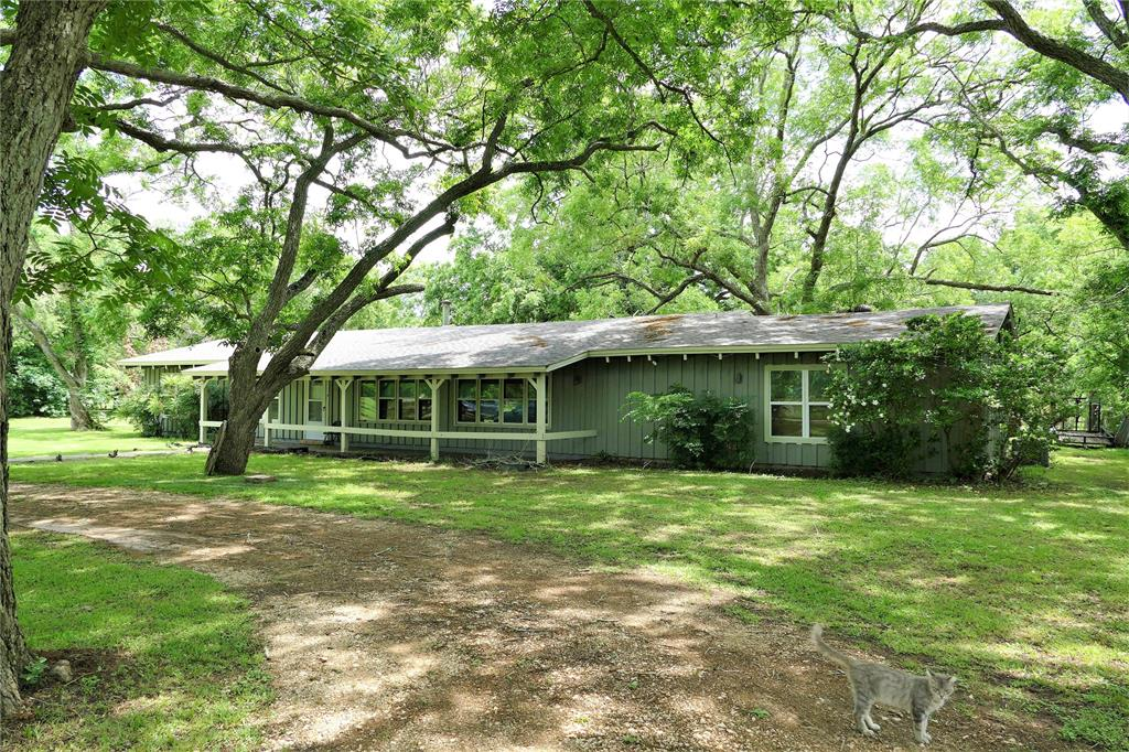 Almost an 1 and 1/2 Acres of land! Surrounded by mature pecan trees, there is a fenced in pasture for your pony or horse!  A barn made out of cedar in need of TLC will make a great family project as it has great bones! The home is an open concept, with a massive island between the kitchen and the family room. Granite and stainless steel countertops, Free standing wood stove fire place, warms the room quickly.  4 Bedrooms, 3 full bathrooms, backyard patio, covered front porch, vacant land across the street.  Enjoy living in the country with excellent Fulshear/LCISD schools, just a short distance from shopping.
