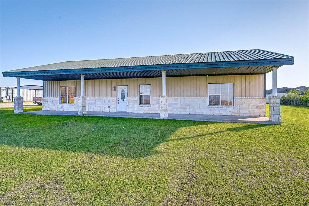 Charming country ranch living! This one has it all! This 2-3 bedroom/2-1/2 bath 1,800 sf home is situated on 10 unrestricted acres close to the highly desired Needville ISD schools! Open ADA accessible floor plan offers great flexible space to relax or entertain. The great room opens to the dining area and a large kitchen with 2 pantries and tons of cabinets. Work from home? Just off the main entry could be your home office! The primary bedroom features 2 large walk-in closets and a spa-like en-suite with luxurious custom walk-in shower. Large laundry room is conveniently located just off kitchen. This property also offers a great 40x60 fully insulated & air conditioned barn/warehouse with separate office area, 1/2 bath, and ample covered parking. (Barn currently leased. Lease expires in May. Awesome rental income potential.) Conveniently located with easy access to Hwy 36 & I-69. Bring your family, your livestock/horses...and your dreams to make this property your forever home!