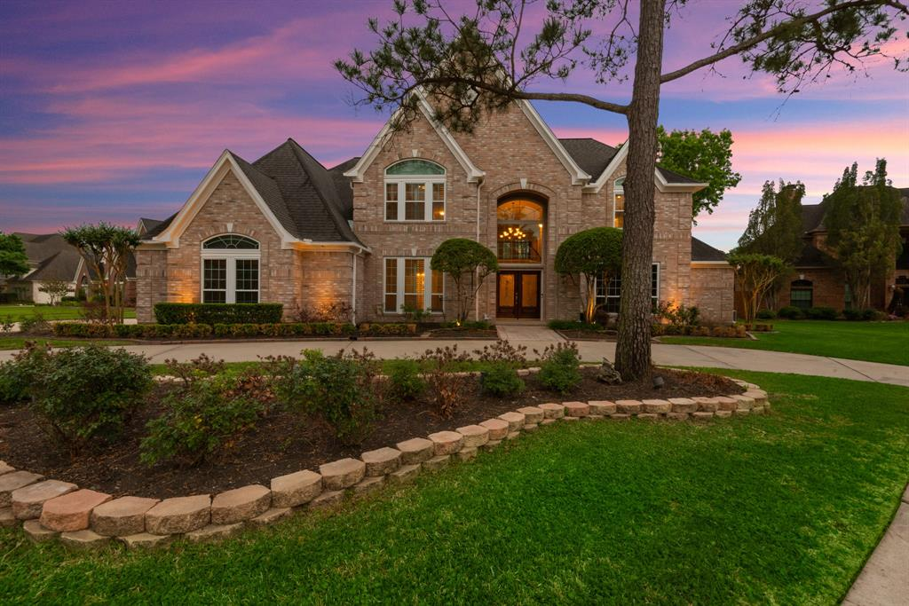 This home is a show stopper! As you drive up you have a circular driveway great for your guest! Beautiful double door entrance & soaring ceilings & double winding wood stair cases & wrought iron spindles. Elegant formal dining room w wood flooring, beautiful molding, & plantation shutters, private study w beautiful wood work & built ins, huge great room w wood flooring & wet bar, this room leads out to your gorgeous sunroom w windows  that look out to your serene backyard w sparkling pool & spa & amazing landscaping & no back neighbors. Beautiful remodeled kitchen w quartz counters, gorgeous backsplash & soft closing cabinet , great living room space w a beautiful wood burning fireplace, huge primary bedroom that has a door out to your stunning backyard, gorgeous remodeled primary bathroom w quartz counters & seamless shower, two large walk in closets. Huge  game room upstairs w wet bar & balcony w the most amazing view! Huge secondary bedrooms all wood flooring throughout upstairs!