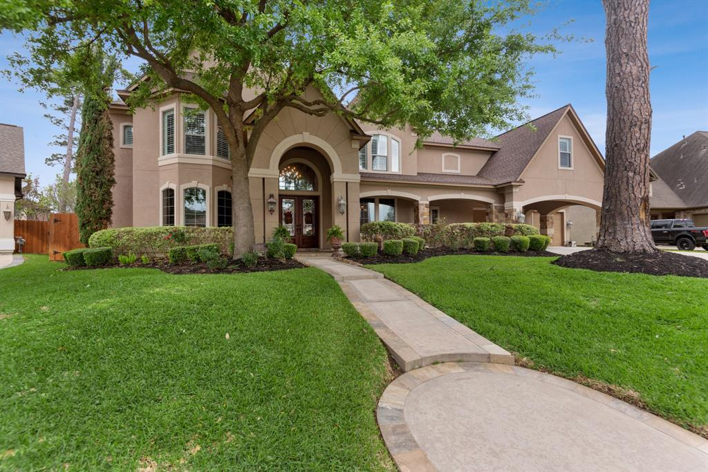 OPEN HOUSE SATURDAY 1-4 PM***This custom Rockwell home sits on one of Rock Creek's favorite streets, just steps away from the lake and walking trails! You're welcomed by a shaded lot with lush landscaping, a slate walkway, and a covered front porch! The double 8' leaded glass doors open to a grand 2 story entry that will not disappoint! Extensive dental crown molding, cove lighting, wrought iron staircase, and custom tile and wood flooring! The grand formal living features a one-of-a-kind ceiling, with large 2 story picture windows that overlook the backyard outdoor living spaces. The kitchen is a chef's dream with a large island, granite counters, gas cooking, double stainless ovens, built in refrigerator, and large breakfast bar! Cozy up in this wonderful den with cathedral ceiling, corner rock fireplace and gorgeous views of the Custom pool and spa. The utility room is a must see! Return stairs! Game room plus media room! Oversized huge garage! Too much to list here.. don't miss it!