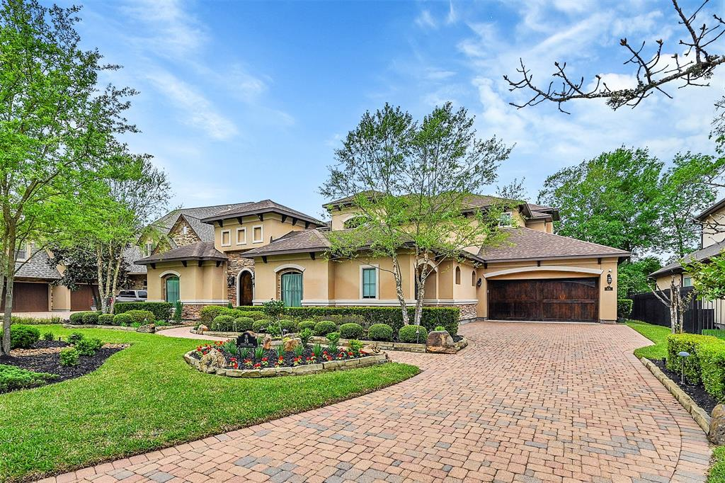 Welcome home to this beautiful Mediterranean two story stucco and stone Partners in Building custom home overlooking the picturesque 4th hole of the Gary Player Golf Course within the Village of Sterling Ridge in The Woodlands. It boasts a covered/non covered courtyard, casita with full bath and walk in closets, hardwood and large tile floors, granite countertops, stainless appliances, wine cellar, large downstairs primary suite. Backyard paradise with pool, oversized covered backyard patio with outdoor kitchen, fireplace, multiple seating areas plus an additional oversized covered balcony area and so much more. Located within a short distance of countless walking paths, nature preserve, community parks, recreation center, resort style pool, fine dining, fishing ponds, multiple golf courses, shopping and more. This one has so much to offer and is a must see!