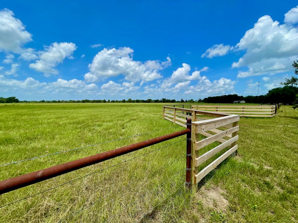 Beautiful country acreage! Hard to find 10.365 +/- lightly restricted acreage in the highly desired area of Bellville Texas. This property comes complete with newly constructed barbed fire-wire perimeter fencing, quality built 4 rail entryway with a culverted entry drive through the property gate. (this tracts entry drive scheduled for completion September 25th, entry drive photos of a neighboring tract with same build specifications) Currently, ag exempt with zero flood plain, the land is primarily open with scattered trees and improved and native grasses. Electric and water are available along the approximate 340 feet of paved county road frontage on school road with easy and quick access to the HWY 159 corridor which will quickly get you anywhere you want to be for business, living or leisure.