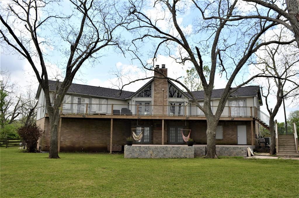 Beautiful two acres with 21 pecan trees on Burton Creek, stalked with fish, great for Kayaking and canoeing. Incredible view from 70x15 foot upper deck. Enjoy the 21x17 foot patio downstairs, fantastic for summer parties. Great game room with wet bar, fireplace and French doors leading to lower patio. Open floorplan, den has ceilings and pretty fireplace. Extra large three car attached garage plus 36x26 foot workshop. This property is a nature lovers dream. Roof is two years old being sold as is!